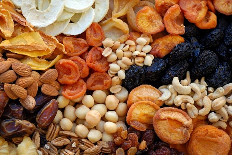 Dried fruit and nuts are high energy and high carbohydrate- food but their GI is relatively low and they fill you up, so they are a good snack food when eaten sparingly